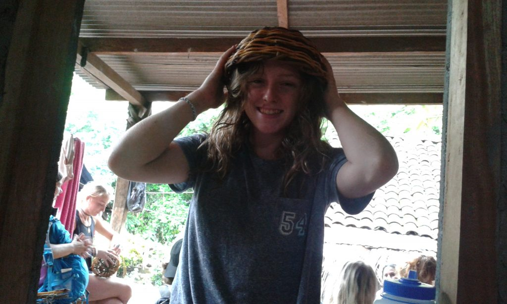 Hannah with her basket / hat.